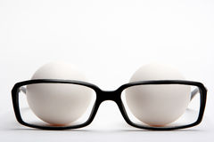 Reading glasses and eggs Stock Image