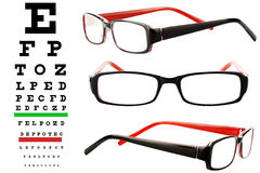 Reading glasses with eye chart. Extreme closeup Royalty Free Stock Photos