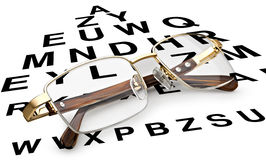 Reading glasses with eye chart Stock Photography