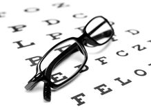 Reading Glasses. Glasses with an eye chart on white Stock Images