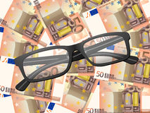 Reading glasses on fifty euro background. Reading glasses on fifty euros background Royalty Free Stock Images