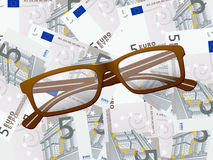 Reading glasses on five euro background Royalty Free Stock Photos