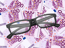 Reading glasses on five hundred euro background Stock Image