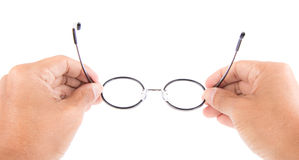 Reading glasses in hand Stock Images