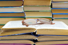 Reading glasses lying on the  book Stock Photos