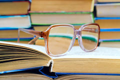 Reading glasses lying on the book Royalty Free Stock Photo