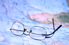 Reading glasses on map Royalty Free Stock Photo