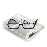 Reading glasses and newspaper Stock Photos
