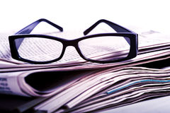 Reading Glasses on Newspapers Stock Photos