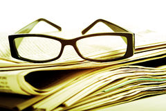 Reading Glasses on Newspapers Stock Photo