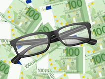 Reading glasses on one hundred euro background Stock Photography
