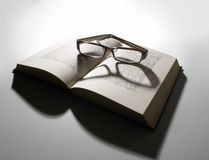 Reading glasses and open book Stock Photo