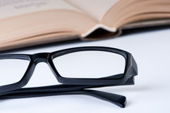 Reading glasses with open book. Royalty Free Stock Image