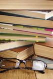 Reading glasses on the opened book Royalty Free Stock Photos