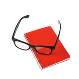 Reading glasses over a notebook Stock Image