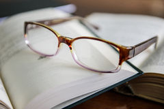 Reading glasses. A pair o reading glasses on a book stock image
