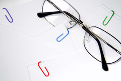 Reading glasses and paper Stock Photos
