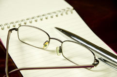Reading glasses and pen Stock Image