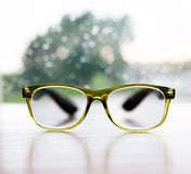 Reading glasses on rainy window background Royalty Free Stock Images