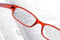 Reading glasses red. On book Stock Photo