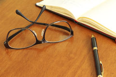 Reading glasses and schedule book and pen Stock Photo