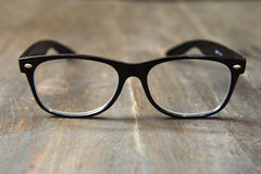 Reading glasses, shallow depth of field. Reading glasse on wooden background royalty free stock photography