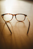 Reading glasses on table. Close-up of reading glasses on table royalty free stock photo