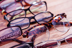 Reading glasses on table. View of reading glasses on table royalty free stock images