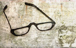 Reading glasses with text overlay Royalty Free Stock Photos