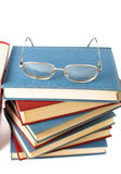 Reading glasses on top of books Stock Photo