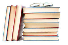 Reading glasses on top of books Royalty Free Stock Photography