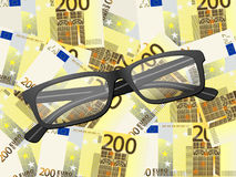 Reading glasses on two hundred euro background. Reading glasses on two hundred euros background Stock Photos