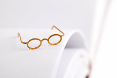 Reading glasses on a white page Royalty Free Stock Images