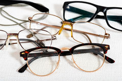 Reading glasses on the white table Royalty Free Stock Photos