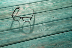 Reading glasses on wood. Reading glasaes on wooden backgroud royalty free stock photos