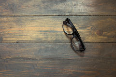 Reading glasses on wooden background. Glasses on the wooden background royalty free stock images