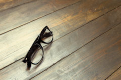 Reading glasses on wooden background. Glasses on the wooden background royalty free stock photos