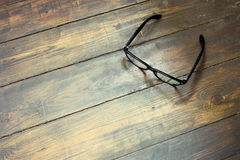 Reading glasses on wooden background. Glasses on the wooden background stock photo