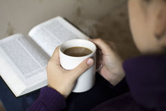 Reading  good book with coffee Royalty Free Stock Photo