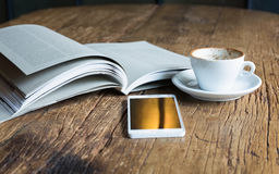 Reading a good book and a cup of coffee Stock Photo
