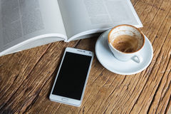 Reading a good book and a cup of coffee Royalty Free Stock Photos