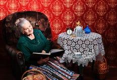 Reading grandma Stock Images