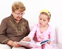 Reading with granny Stock Photos