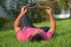 Reading in the grass Royalty Free Stock Photo