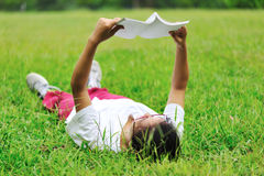 Reading on grass Stock Photo