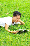 Reading on grass Stock Images