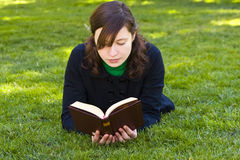 Reading on the grass Stock Photography