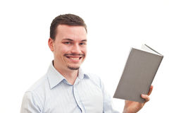 Reading a grey book. A caucasian male is reading a grey book isolated on a white background Stock Images