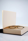 Reading habit. Book and a pair of spectacle royalty free stock photos