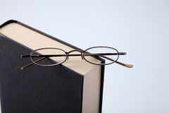 Reading habit. Book and a pair of spectacle royalty free stock photography